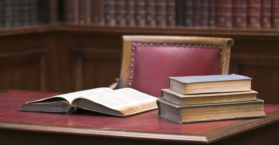 Books of Criminal Reports on Desk